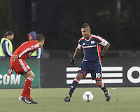 New England Revolution midfielder Juan Agudelo (10) dribbles. In a Major League Soccer (MLS) match, the New England Revolution (blue) defeated Toronto FC (red), 2-0, at Gillette Stadium on May 25, 2013.