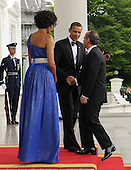 United States President Barack Obama shakes hands with Mexican President Felipe Calderon while First Lady Michelle Obama looks on as the Obamas welcome Calderon and Mexican First Lady Margarita Zavala on the North Portico of the White House for a State Dinner in Washington on May 19, 2010.   .Credit: Roger L. Wollenberg - Pool via CNP
