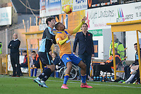 Mansfield Town's Reggie Lambe controls the ball under pressure from Wycombe Wanderers Joe Jacobson during the Sky Bet League 2 match between Mansfield Town and Wycombe Wanderers at the One Call Stadium, Mansfield, England on 31 October 2015. Photo by Garry Griffiths.