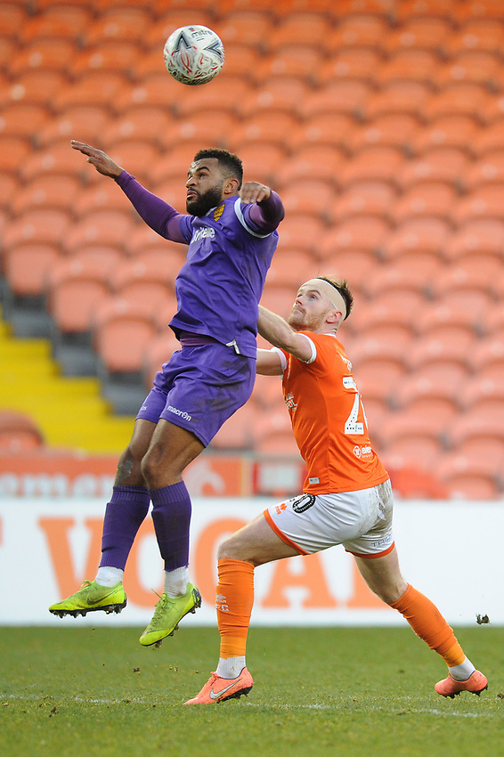 Maidstone United's Dan Wishart under pressure from Blackpool's Oliver Turton<br /> <br /> Photographer Kevin Barnes/CameraSport<br /> <br /> Emirates FA Cup Second Round - Blackpool v Maidstone United - Sunday 1st December 2019 - Bloomfield Road - Blackpool<br />  <br /> World Copyright © 2019 CameraSport. All rights reserved. 43 Linden Ave. Countesthorpe. Leicester. England. LE8 5PG - Tel: +44 (0) 116 277 4147 - admin@camerasport.com - www.camerasport.com