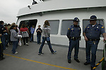 Washington State Troopers conducting anti-terrorism patrols on Washington State Ferries to and from Seattle's Coleman Dock .  Jim Bryant Photo. ©2010. All Rights Reserved.