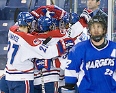 Zack Kamrass (UML - 27), Stephen Buco (UML - 11), Scott Wilson (UML - 23) - The University of Massachusetts-Lowell River Hawks defeated the University of Alabama-Huntsville Chargers 3-0 on Friday, November 25, 2011, at Tsongas Center in Lowell, Massachusetts.