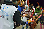 Staff from ACT Alliance member Hungarian Interchurch Aid offer food to refugees at Beremend, along Hungary's border with Croatia. Hundreds of thousands of refugees and migrants flowed through Hungary in 2015 on their way to western Europe from Syria, Iraq and other countries.