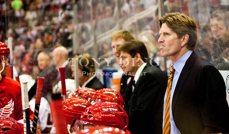 8 October 2010: Detroit Red Wings head coach Mike Babcock, right, watches game action from the back of his team's bench in the second period of the Anaheim Ducks at Detroit Red Wings NHL hockey game, at Joe Louis Arena, in Detroit, MI...***** Editorial Use Only *****