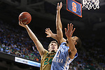 14 March 2015: Notre Dame's Pat Connaughton (24) and North Carolina's Brice Johnson (11). The Notre Dame Fighting Irish played the University of North Carolina Tar Heels in an NCAA Division I Men's basketball game at the Greensboro Coliseum in Greensboro, North Carolina in the ACC Men's Basketball Tournament quarterfinal game. Notre Dame won the game 90-82.