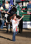 Jasmine West sings the National Anthem at the Reno Rodeo in Reno, Nev. on Friday, June 19, 2015.<br /> Photo by Cathleen Allison/Nevada Photo Source