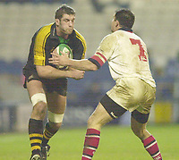 London. Great Britain. Wasps Simon Shaw runs into Ulster's Capt. Andy Ward,  during the Heineken Cup.London Wasps v Ulster Match, played at Loftus Road, West London. 06/01/2002.  [Mandatory Credit;  Peter Spurrier/Intersport Images]..