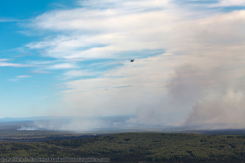 Forest fire plumes in the Tanana Valley flats near Fairbanks Alaska on a record breaking 91 degree temperature day, August 15, 2010