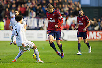 14.12.2013, Pamplona, Spain. La Liga football Osasuna  versus  Real Madrid.    Oriol Riera, Osasuna striker, and Pepe, Real Madrid defender, during the game between Osasuna and Real Madrid  from the Estadio de El Sadar.