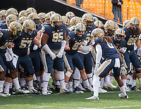 Pitt Panther senior Layafette Pitts (6) fires up the Pitt team before they take the field for warmups. The Miami Hurricanes football team defeated the Pitt Panthers 29-24 on  Friday, November 27, 2015 at Heinz Field, Pittsburgh, Pennsylvania.