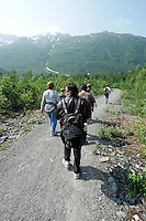 Visitors walk the trail to Spencer Glacier. The Alaska Railroad's Spencer Glacier Whistlestop train gives visitors access to hiking, camping and stunning views.