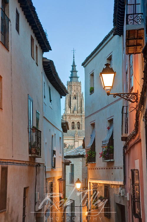 Europe, Spain, Toledo, Alleyway and Toledo Cathedral Steeple