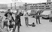 Photographers shooting the newly crowned Gala Queen. the Education Centre, Festival & Gala Day, Wester Hailes, Scotland, 1979.  John Walmsley was Photographer in Residence at the Education Centre for three weeks in 1979.  The Education Centre was, at the time, Scotland's largest purpose built community High School open all day every day for all ages from primary to adults.  The town of Wester Hailes, a few miles to the south west of Edinburgh, was built in the early 1970s mostly of blocks of flats and high rises.