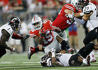 Ohio State Buckeyes running back Ezekiel Elliott (15) gets taken down by Cincinnati Bearcats linebacker Nick Temple (43) as he rushes the ball in the third quarter of the college football game between the Ohio State Buckeyes and the Cincinnati Bearcats at Ohio Stadium in Columbus, Saturday afternoon, September 27, 2014. The Ohio State Buckeyes defeated the Cincinnati Bearcats 50 - 28. (The Columbus Dispatch / Eamon Queeney)