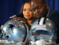 NFL running back Emmitt Smith fights back his emotions as he places his hand atop a Dallas Cowboys helmet upon announcing his retirement from the league at the NFL Super Bowl Media Center in Jacksonville, Fl. His wife Pat (left) was at his side as well as Dallas Cowboys' owner Jerry Jones. (Rick Wilson/The Florida Times-Union)