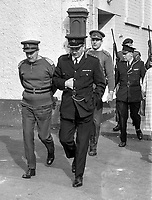 RUC Chief Supt Frank Lagan accompanied by British Army personnel goes walkabout in Derry's Bogside, August 1969. Lagan's appearance would have been highly symbolic as it was almost certainly the first appearance of a uniformed RUC officer in the area since the Battle of the Bogside when the RUC were forced out. 196908000023..Copyright Image from Larry Doherty, c/o Victor Patterson, 54 Dorchester Park, Belfast, UK, BT9 6RJ..Tel: +44 28 9066 1296.Mob: +44 7802 353836.Voicemail +44 20 8816 7153.Skype: victorpattersonbelfast.Email: victorpatterson@mac.com.Email: victorpatterson@ireland.com (back-up)..IMPORTANT: If you wish to use this image or any other of my images please go to www.victorpatterson.com and click on the Terms & Conditions. Then contact me by email or phone with the reference number(s) of the image(s) concerned.