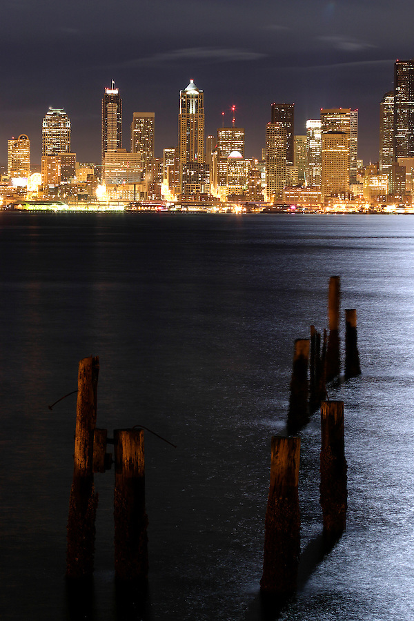 Pilings in Elliot Bay with Seattle skyline in background viewed from West Seattle, Seattle, Washington, USA