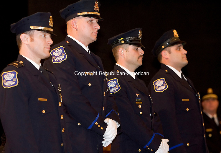 WATERBURY, CT -13 DECEMBER 2005 -121305J02---Waterbury Police officers, from left, Sgt. Edward Apicells, officers Raymond Alenckis and David Terni and Detective Michael Slavin were  honored during the Waterbury Police Department's annual Recognition Awards Ceremony at Holy Cross High School Tuesday in Waterbury.  Along with 46 awards to officers, five civilians awards were given for bravery.   --  Jim Shannon Republican-American--Waterbury; Waterbury Police Department; Holy Cross High School; Sgt. Edward Apicells; officer's Raymond Alenckis and David Terni and Detective Michael Slavin are CQ
