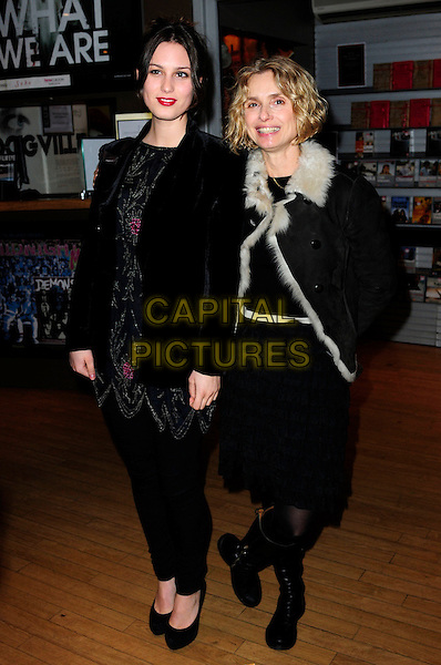GUEST & MIRIAM D'ABO.An Academy Tribute To Jeremy Thomas,.Curzon Soho,Shaftesbury Avenue, London, England..November 25th 2010.full length black coat jacket fur lined sheepskin trousers dress tights  .CAP/CAS.©Bob Cass/Capital Pictures.