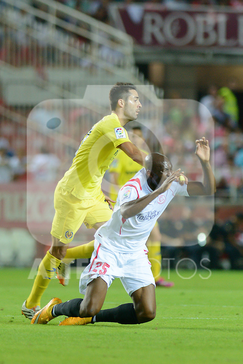 Sevilla's Mbia falls to ground during the match between Sevilla FC and Villarreal day 9 spanish  BBVA League 2014-2015 day 5, played at Sanchez Pizjuan stadium in Seville, Spain.(PHOTO: CARLOS BOUZA / BOUZA PRESS / ALTER PHOTOS)