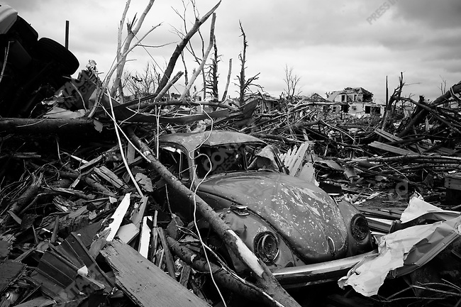 A Volkswagon Beetle trapped in debris on Gabby Street. Joplin, Mo. May 26, 2011...