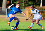 BURLINGTON ,  CT-101519JS18-  Lewis Mills' Grace Annonson (10) settles the ball in front of Newington's Sabrina Soler (23) during their game Tuesday at Nassahegan Field in Burlington. <br /> Jim Shannon Republican-American