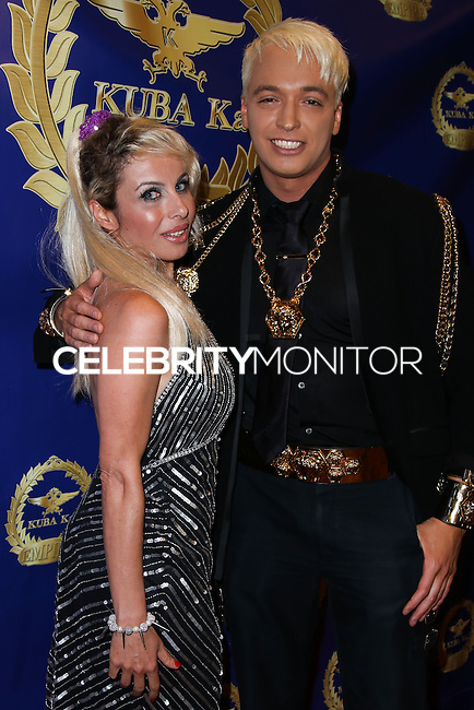 BEVERLY HILLS, CA, USA - MARCH 28: Sabrina Parisi, KUBA Ka at the Versace Unveiling Of The 1st Pop Recording Artist Superhero - KUBA Ka's Performance Outfits. Designed by the legendary fashion hosuse - Donatella Versace. For the Benefit of the Face Forward Foundation (Plastic Surgery for Destroyed Faces from Violence). Pop entertainer TV personality KUBA Ka, together with VERSACE, unveiled Kuba Ka's new Versace images, for the First Pop Artist/Superhero of the World. He has become the inspiration of Donatella's newest and wildest creations and will celebrate the launch of his new power house conglomerate - KUBA Ka Empire Inc. in collaboration with the sensational fashion house - VERSACE on Friday, his birthday at a red carpet media and celebrity event at the luxurious Peninsula Hotel in Beverly Hills held at the Peninsula Hotel on March 28, 2014 in Beverly Hills, California, United States. (Photo by Xavier Collin/Celebrity Monitor)