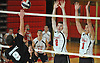 Floral Park No. 8 Shane O'Sullivan, center, and No. 7 Nick Felicetti defend against a spike attempt by Farmingdale No. 9 Ryan McGivney during a Nassau County varsity boys' volleyball match at Floral Park High School on Thursday, September 24, 2015. Floral Park won 23-25, 25-19, 25-15, 25-12.<br /> <br /> James Escher