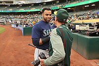 OAKLAND, CA - AUGUST 13:  Nelson Cruz #23 of the Seattle Mariners shakes hands with Oakland Athletics team photographer Michael Zagaris before their game at the Oakland Coliseum on Monday, August 13, 2018 in Oakland, California. (Photo by Brad Mangin)
