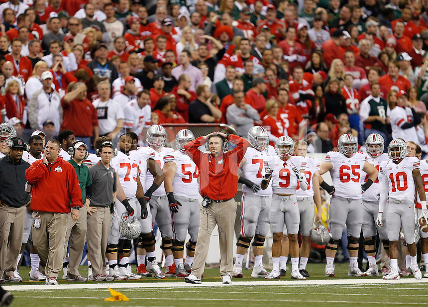 Ohio State Buckeyes head coach Urban Meyer reacts to a penalty on a Michigan State third down against Ohio State during the first half of the Big Ten Championship football game at Lucas Oil Stadium in Indianapolis on Friday, December 7, 2013. (Columbus Dispatch photo by Jonathan Quilter)