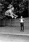 """This is how its done, Dad"" yells Susan Ford, left, to her father, United States President Gerald R. Ford, right, as she bounces high into the air off a trampoline at Camp David near Thurmont, Maryland on September 2, 1974.<br /> Mandatory Credit: David Hume Kennerly / White House via CNP"