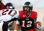 BRANDON, SD - SEPTEMBER 26: Drew Reinschmidt #12 from Brandon Valley looks to gain yardage as Cole Uithoven #20 from Washington fights his way to him in the first quarter of their game Friday night in Brandon.  (Photo by Dave Eggen/Inertia)