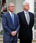 Former Presidents Bill Clinton (R) and George W. Bush listen to remarks by President Barack Obama after their meeting with Obama in the  aftermath of the devastating earthquake in Haiti, at the White House in Washington, DC, USA, 16 January 2010.  Obama discussed enlisting the help of the American people to help in the recovery and rebuilding of Haiti.   .Credit: Mike Theiler / Pool via CNP