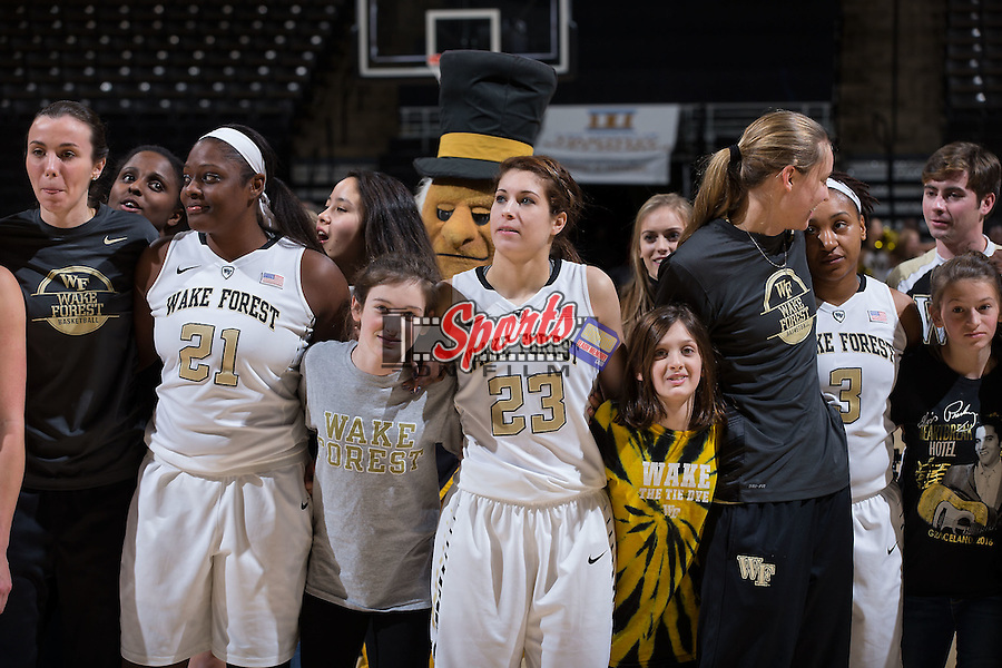 Keyonna Allen (21) and Amber Long (23) of the Wake Forest Demon Deacons celebrate with fans following their win over the North Carolina Tar Heels at the LJVM Coliseum on January 21, 2016 in Winston-Salem, North Carolina.  The Demon Deacons defeated the Tar Heels 75-63.  (Brian Westerholt/Sports On Film)