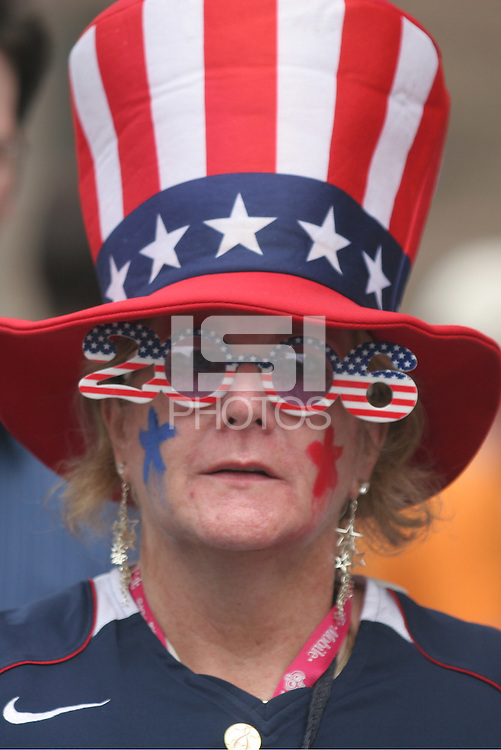 An USA National Soccer Team supporter is  decked out in patriotic USA garb in the old town  of Nuremburg, Germany before their FIFA World Cup first round match at  the Nuremburg World Cup stadium on Thursday, June 22nd, 2006.  Ghana defeated the USA 2-1.