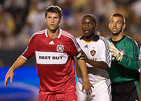 LA Galaxy midfielder Mike Randolph (2-c) and Chicago Fire midfielder Logan Pause (7-l) and goalkeeper Jon Busch (1-r) line up for a corner kick during a MLS match. The Chicago Fire defeated the LA Galaxy 1-0 at Home Depot Center stadium in Carson, California on Thursday, August 21, 2008.
