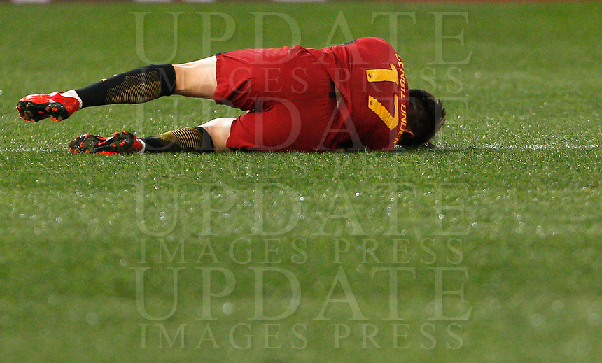 Roma s Cengiz Under lies on the pitch after being injured during the Uefa Champions League round of 16 second leg soccer match between Roma and Shakhtar Donetsk at Rome's Olympic stadium, March 13, 2018. Roma won. 1-0 to join the quarter finals.<br /> UPDATE IMAGES PRESS/Riccardo De Luca