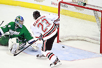 Mercyhurst goalie Max Strang watches as Nebraska Omaha's Johnnie Searfoss bounces a shot off the post. (Photo by Michelle Bishop) ..
