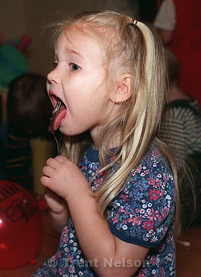 Lauren ? eating cake at Noah's 3rd birthday party.<br />