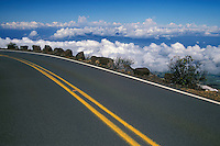 High above the clouds, the road to HALEAKALA NATIONAL PARK on Maui presents a challenge to safe driving and sightseeing