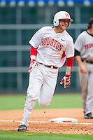 Caleb Barker #27 of the Houston Cougars rounds third base on his way to scoring a run against the Texas Tech Red Raiders at Minute Maid Park on February 28, 2014 in Houston, Texas.  The Cougars defeated the Red Raiders 9-0.  (Brian Westerholt/Four Seam Images)