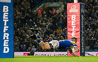 Picture by Allan McKenzie/SWpix.com - 08/02/2018 - Rugby League - Betfred Super League - Leeds Rhinos v Hull KR - Elland Road, Leeds, England - Adam Cuthbertson dives over for a try, Betfred, branding.