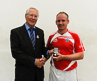 20th September 2014; <br /> Dale Cusack is presented with the gold medal by GAA Handball President Willie Roche<br /> M Donnelly All-Ireland Mens Over-35 60x30 Handball Singes Final.<br /> Dale Cusack (Cork) v Conor O'Connor (Meath)<br /> Abbeylara, Co Longford.<br /> Picture credit: Tommy Grealy/actionshots.ie