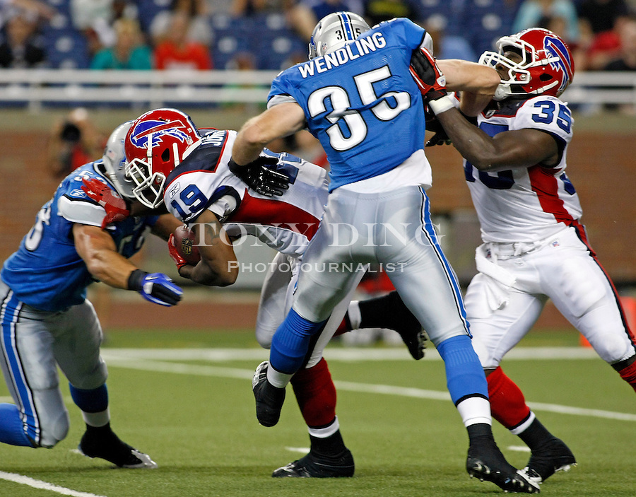 Detroit Lions linebacker Caleb Campbell, left, tackles Buffalo Bills wide receiver Naaman Roosevelt (18), as Lions safety John Wendling (35) holds back Bills running back Joique Bell (35), in the third quarter of a preseason NFL football game, Thursday,  Sept. 2, 2010, in Detroit. The Lions won 28-23. (AP Photo/Tony Ding)