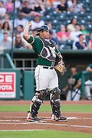Greensboro Grasshoppers catcher Felix Castillo (14) throws the ball back to his pitcher during the game against the Greenville Drive at NewBridge Bank Park on August 17, 2015 in Greensboro, North Carolina.  The Drive defeated the Grasshoppers 5-4 in 13 innings.  (Brian Westerholt/Four Seam Images)
