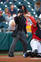 Umpire Ian Fazio makes a call during a game between the Pawtucket Red Sox and Buffalo Bisons on August 28, 2015 at Coca-Cola Field in Buffalo, New York.  Pawtucket defeated Buffalo 7-6.  (Mike Janes/Four Seam Images)