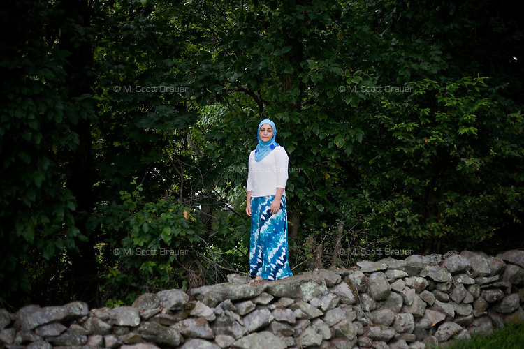 """Shayreen, 16, poses for a portrait in the backyard of her home in West Warwick, Rhode Island, USA, on Sunday, Aug. 22, 2011.  Unlike the rest of her family, Shayreen is very devoted to her Muslim faith.  """"I feel it's my responsibility as a Muslim to be a positive role model,"""" said Shayreen, """"I see a negative energy toward Muslims in the media.""""  Shayreen is will be a high school junior at Lincoln School, an all-girls Quaker school in Rhode Island. The rest of her family is not particularly religious.  When Shayreen began wearing the hijab head covering in her early teens, """"My parents were very supportive, but my aunt tried to talk me out of it. My grandmother was upset.  I was more worried about what my family would think [than what other people would think].""""..photo by: M. Scott Brauer for Education Week"""