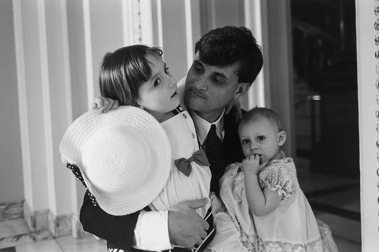 Rep. Rob Andrews, D-N.J., holds daughters Jacquelyn (age 3 1/2) and Joise (18 months) before taking them to House floor to vote, on April 29, 1996. (Photo by Laura Patterson/CQ Roll Call via Getty Images)