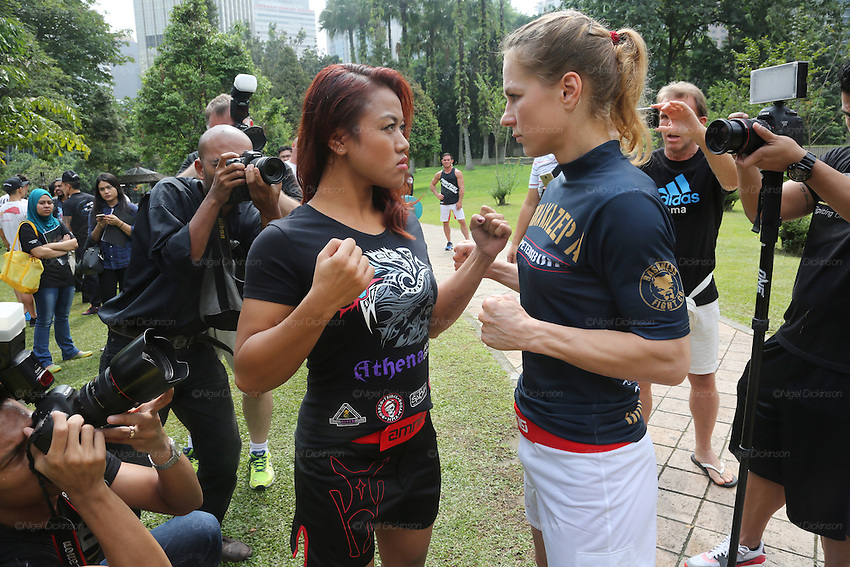 Face Off. Irina Mazepa, 5X Wushu World Champion, fighting Ann Osman, Malaysia WMMA star<br /><br />MMA. Mixed Martial Arts &quot;Tigers of Asia&quot; cage fighting competition. Top professional male and female fighters from across Asia, Russia, Australia, Malaysia, Japan and the Philippines come together to fight. This tournament takes place in front of a ten thousand strong crowd of supporters in Pelaing Stadium. Kuala Lumpur, Malaysia. October 2015