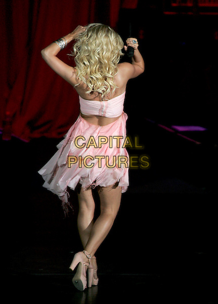 JESSICA SIMPSON.Performs live during her Reality Tour 2004 at The Pacific Ampitheatre in Costa Mesa, California .July 31,2004 .stage, music, concert, gig, singing, full length, pink dress, flowing, layered,  dancing, back, behind, rear.www.capitalpictures.com.sales@capitalpictures.com.Supplied By Capital Pictures